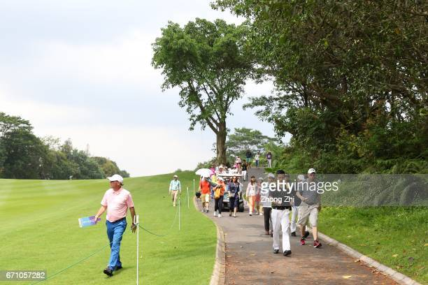 Audience walk with players during the second round of the Shenzhen International at Genzon Golf Club on April 21 2017 in Shenzhen China