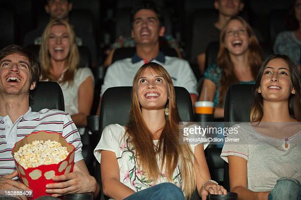 Audience watching movie in theater