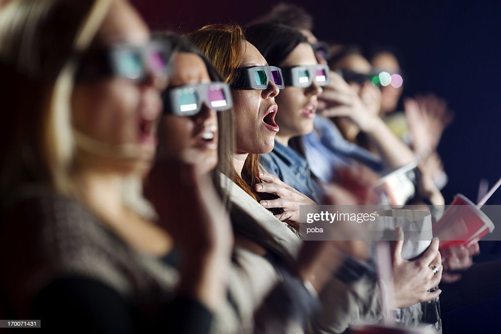 Audience Watching  Movie with 3-d glasses in cinema
