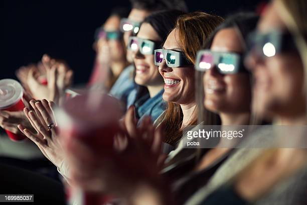 Audience Watching Movie with 3-d glasses.