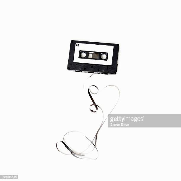 Audio cassette tape unraveled on table