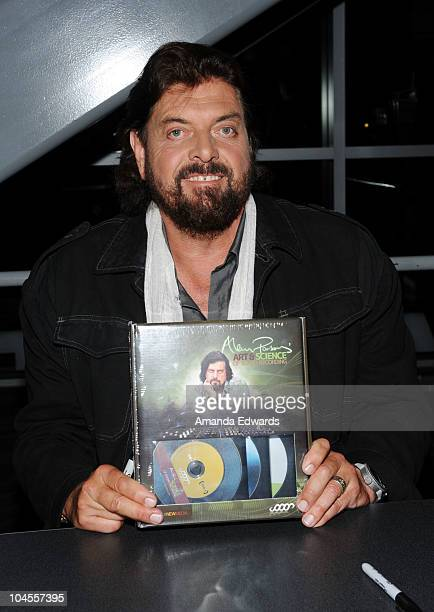 Audio engineer and musician Alan Parsons greets fans after performing onstage at 'An Evening With Alan Parsons' at the GRAMMY Museum on September 29...