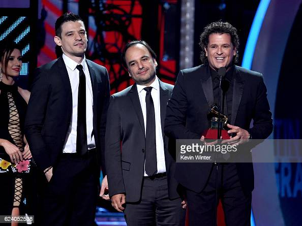 Audio engineer Luis Barrera Jr producer Andres Castro and singer/songwriter Carlos Vives accept Song of the Year for 'La Bicicleta' onstage during...