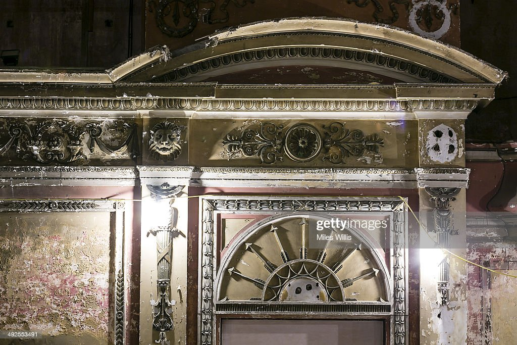 Auditoriaum entrance and surround lies derelict in Alexandra Palace Theatre on May 16, 2014 in London, England. Alexandra Palace situated in the London Borough of Haringey First opened as 'The People's Palace' in 1873. Just 16 days later a fire broke out in the Palace, burning it down in its entirety. On 2 November the world's first regular high-definition public television broadcast took place from the BBC studios at Alexandra Palace. In 1980 fire again burned a large part of the building, the Palace reopened in 1988. Recently awarded a Round 1 pass from The Heritage Lottery Fund the Palace plans to renovate parts of the derelict building including the BBC Studios and Victorian Theatre.