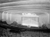 Auditorium of the Odeon Leicester Square London 1937 The decor is characterised by Art Deco motifs with figures springing towards the stage An organ...