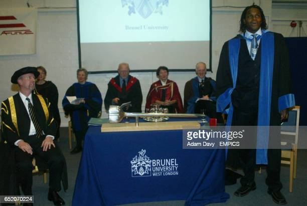 Audley Harrison gives a speech after being awarded an honoury degree by Professor Steve Hodkinson