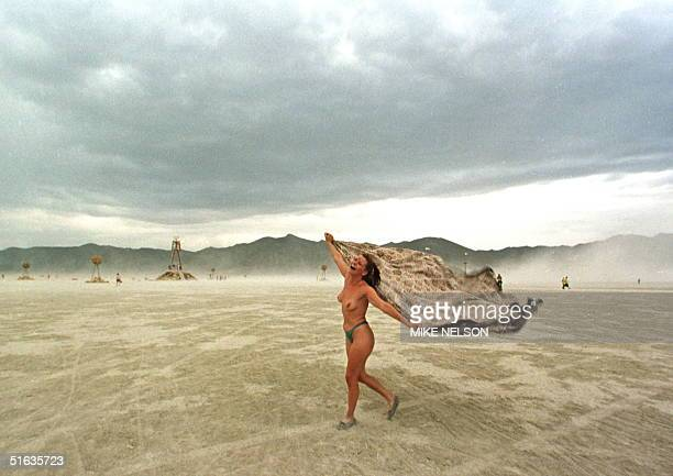 Audra dances on the windswept playa of the Black Rock Desert in northern Nevada during the Burning Man Festival 05 September Over 10000 people have...