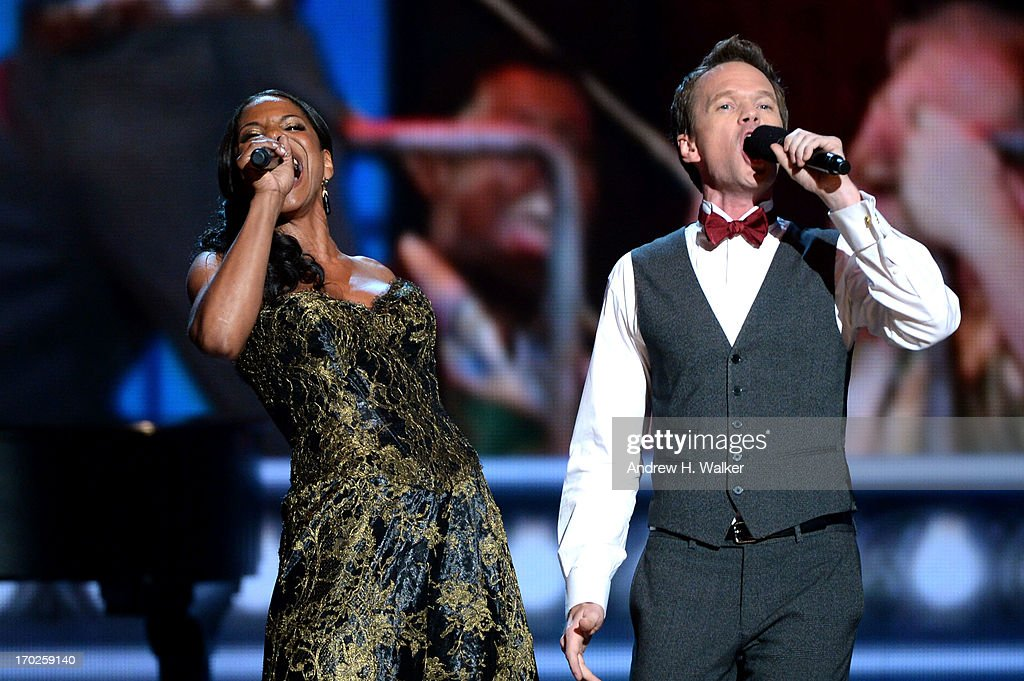<a gi-track='captionPersonalityLinkClicked' href=/galleries/search?phrase=Audra+McDonald&family=editorial&specificpeople=212782 ng-click='$event.stopPropagation()'>Audra McDonald</a> (L) and <a gi-track='captionPersonalityLinkClicked' href=/galleries/search?phrase=Neil+Patrick+Harris&family=editorial&specificpeople=210509 ng-click='$event.stopPropagation()'>Neil Patrick Harris</a> perform onstage at The 67th Annual Tony Awards at Radio City Music Hall on June 9, 2013 in New York City.