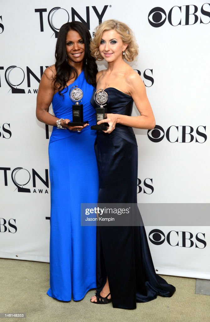 <a gi-track='captionPersonalityLinkClicked' href=/galleries/search?phrase=Audra+McDonald&family=editorial&specificpeople=212782 ng-click='$event.stopPropagation()'>Audra McDonald</a>, Best Performance by a Leading Actress in a Musical for Porgy and Bess, and <a gi-track='captionPersonalityLinkClicked' href=/galleries/search?phrase=Nina+Arianda&family=editorial&specificpeople=6796662 ng-click='$event.stopPropagation()'>Nina Arianda</a>, Best Performance by a Leading Actress in a Play for Venus in Fur, pose with their awards in the press room at the 66th Annual Tony Awards at The Beacon Theatre on June 10, 2012 in New York City.
