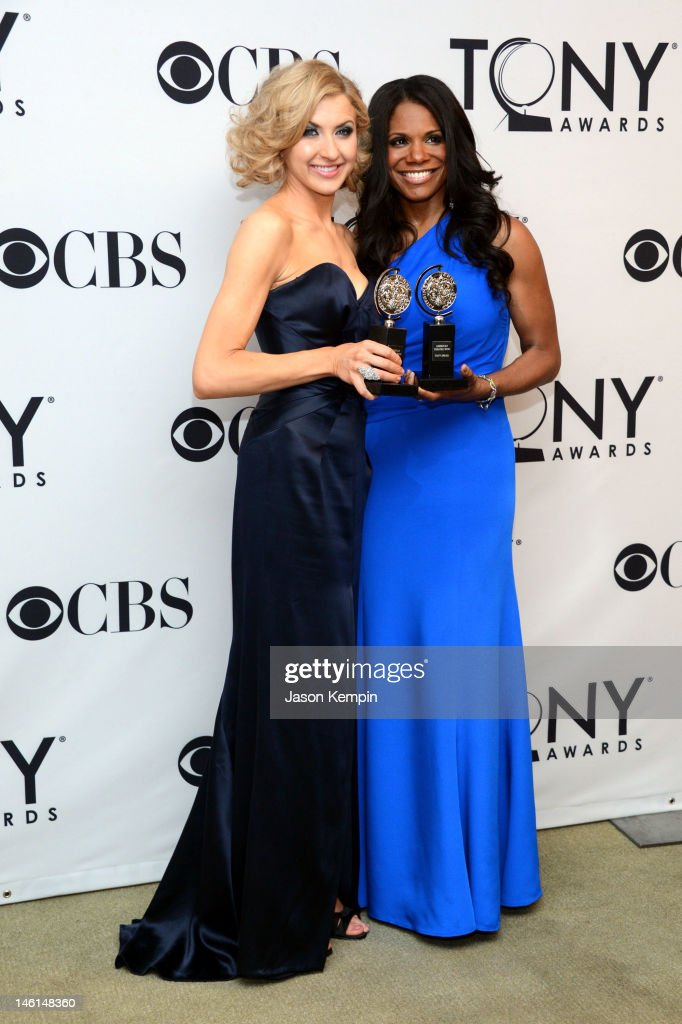 <a gi-track='captionPersonalityLinkClicked' href=/galleries/search?phrase=Audra+McDonald&family=editorial&specificpeople=212782 ng-click='$event.stopPropagation()'>Audra McDonald</a> (R), Best Performance by a Leading Actress in a Musical for Porgy and Bess, and <a gi-track='captionPersonalityLinkClicked' href=/galleries/search?phrase=Nina+Arianda&family=editorial&specificpeople=6796662 ng-click='$event.stopPropagation()'>Nina Arianda</a>, Best Performance by a Leading Actress in a Play for Venus in Fur, pose with their awards in the press room at the 66th Annual Tony Awards at The Beacon Theatre on June 10, 2012 in New York City.