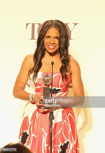 Audra McDonald winner of the award for award for Best Performance by an Actress in a Leading Role in a Play for 'Lady Day' speaks in the press room...