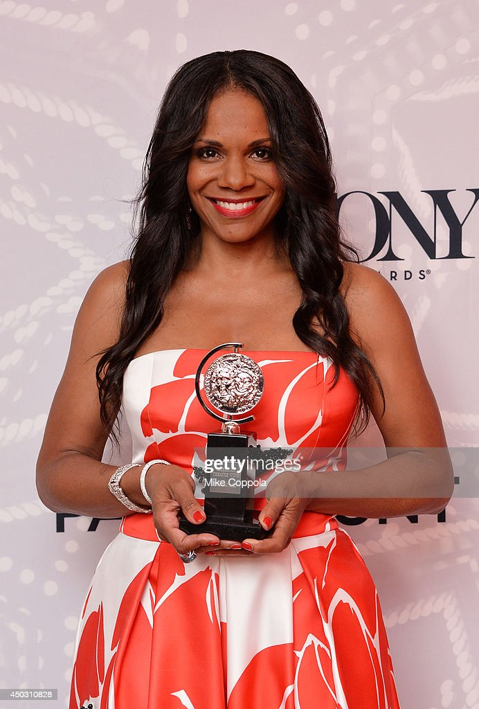 "Audra McDonald, winner of the award for Best Performance by an Actress in a Leading Role in a Play for ""Lady Day"", poses in the Paramount Hotel Winners' Room at the 68th Annual Tony Awards on June 8, 2014 in New York City."