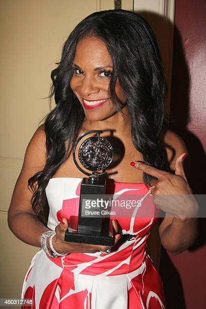 Audra McDonald winner of the award for Best Performance by an Actress in a Leading Role in a Play for 'Lady Day' poses in the press room during the...