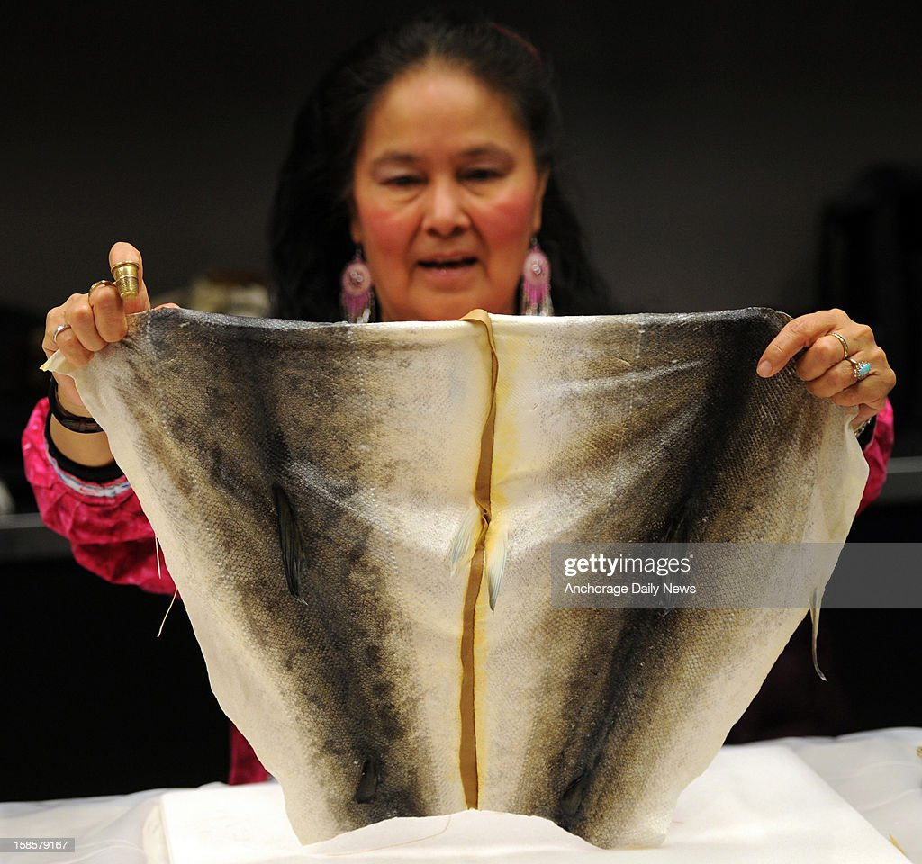 Audrey Armstrong, of Huslia, examines her seam while sewing salmon skins together at the Smithsonian Arctic Studies Center, December 5, 2012 in the Anchorage Museum at Rasmuson Center.