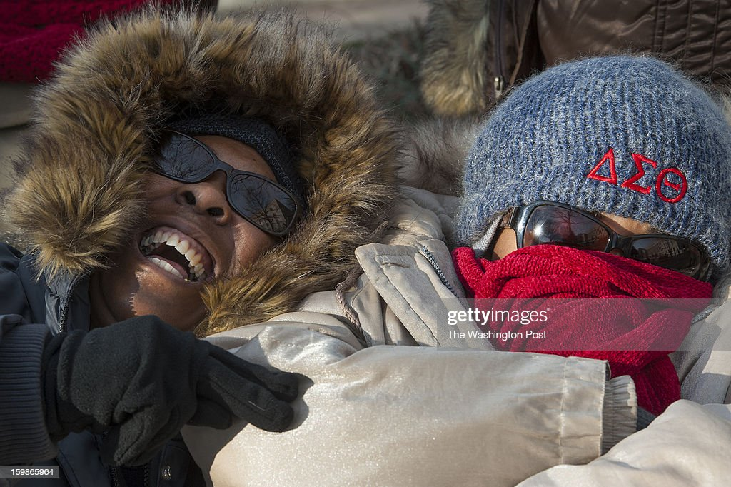 Audrey Black-Tureaud, 53, laughs as she tries to wake up her sleeping niece, Avis Chapman, 41, both from West Palm Beach, FL, Monday, January 21, 2013 in Washington, DC.