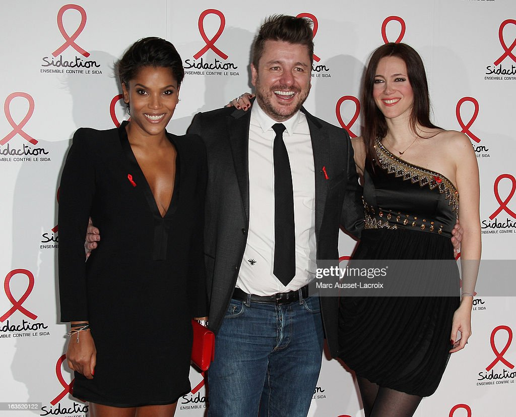 Audrey Chauveau, Bruno Guillon and Sandra Lou pose during the Sidaction 2013 - Photocall at Musee du Quai Branly on March 11, 2013 in Paris, France.