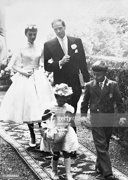 Audrey Hepburn and Mel Ferrer leave the chapel after their wedding at Burgenstock Mountain overlooking Lake Lucerne The flower girl and page are the...