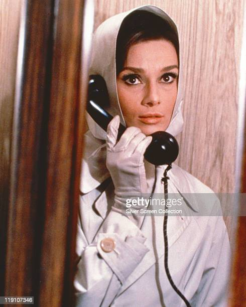 Audrey Hepburn British actress holding a telephone receiver in a publicity still issued for the film 'Charade' 1963 The film comedy directed by...