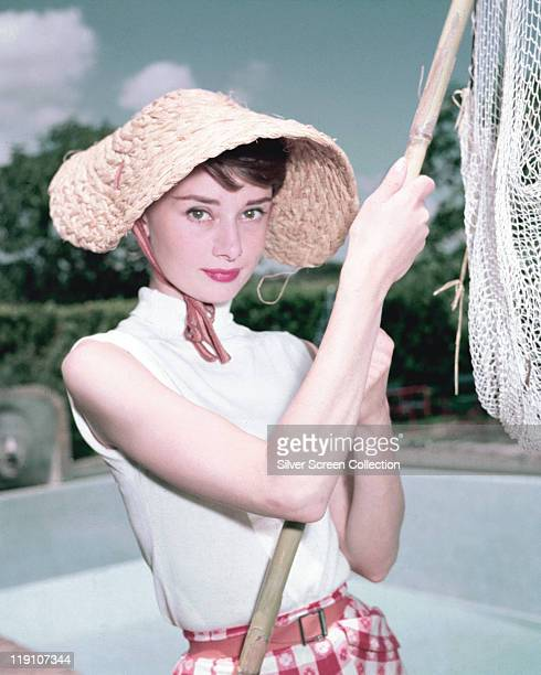Audrey Hepburn British actress wearing a straw hat and holding a fishing net 1965