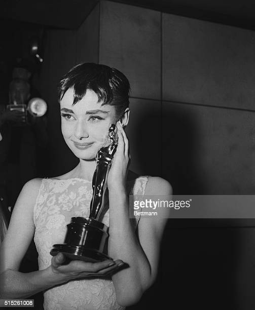 Audrey Hepburn holding the Academy Award for best actress in Roman Holiday her first American film