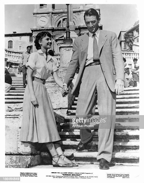 Audrey Hepburn holds hands with Gregory Peck in a scene from the film 'Roman Holiday' 1953