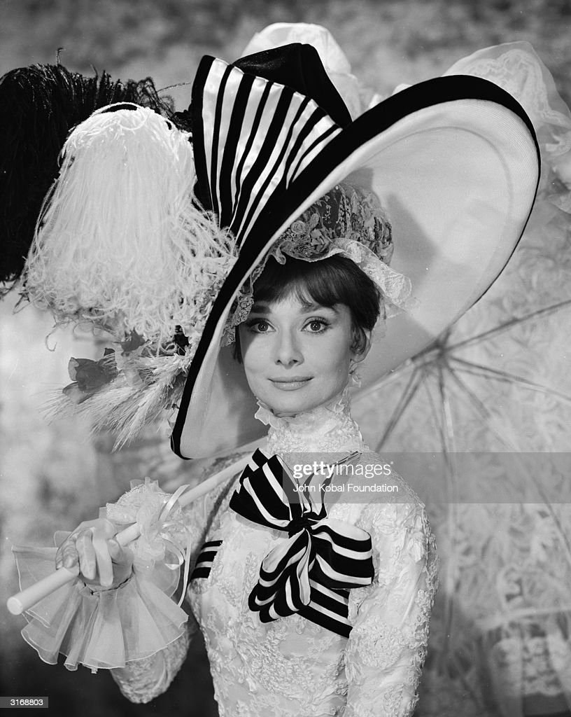 Audrey Hepburn (1929-1993), in extravagant frills and hat, as Eliza Doolittle in 'My Fair Lady', directed by George Cukor.