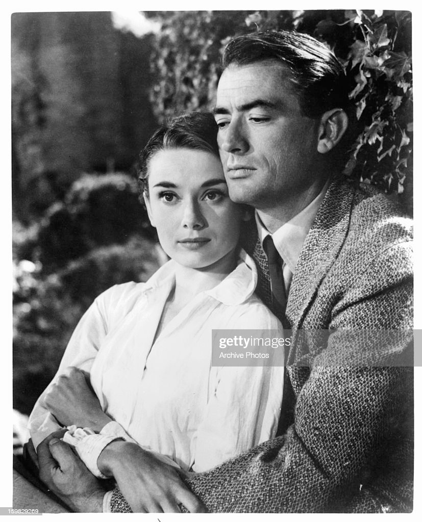 Audrey Hepburn is held by Gregory Peck in a scene from the film 'Roman Holiday', 1953.