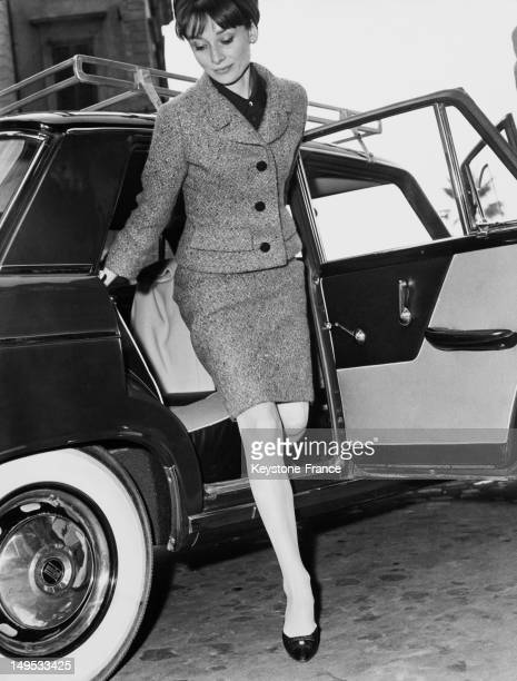 Audrey Hepburn steps out of a car on March 11 1964 in Rome Italy