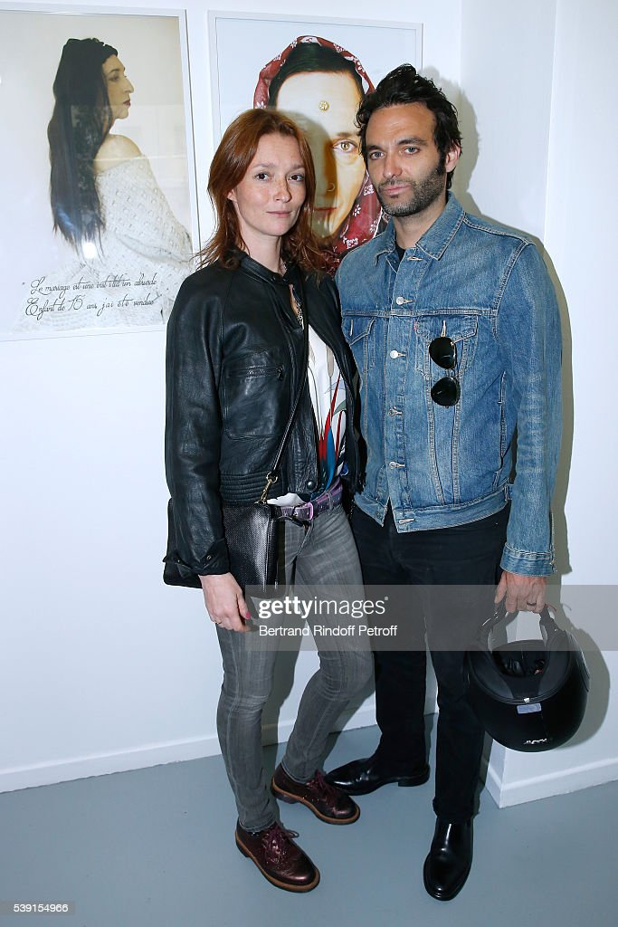 Audrey Marnay (L) and guest attend the '55 Politiques', Exhibition of Stephanie Murat's Pictures - Opening Party at Galerie Dupin on June 9, 2016 in Paris, France.