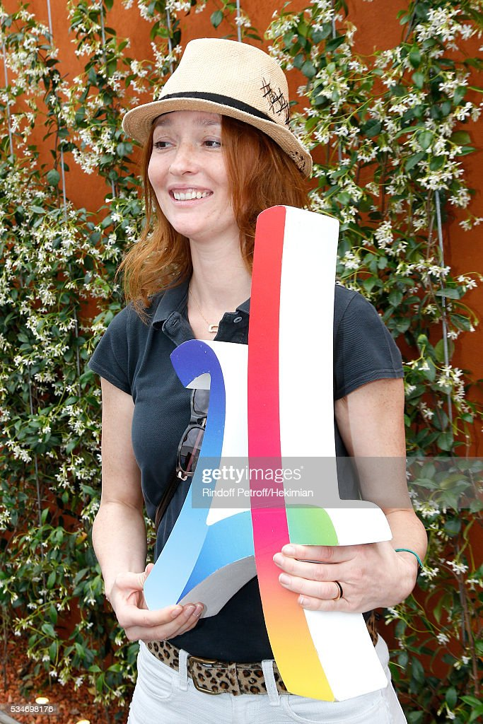 <a gi-track='captionPersonalityLinkClicked' href=/galleries/search?phrase=Audrey+Marnay&family=editorial&specificpeople=622579 ng-click='$event.stopPropagation()'>Audrey Marnay</a> poses with the Logo of the Paris 2024 Olympic Games Candidature during the 2016 French Tennis Open - Day Six at Roland Garros on May 27, 2016 in Paris, France.