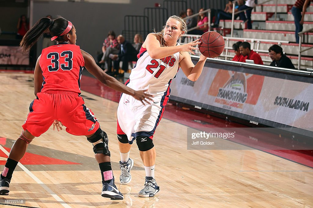 Audrey Matteson #21 of the Detroit Titans passes against Mansa El #33 of the South Alabama Jaguars at The Matadome on November 24, 2012 in Northridge, California. South Alabama defeated Detroit 59-56.
