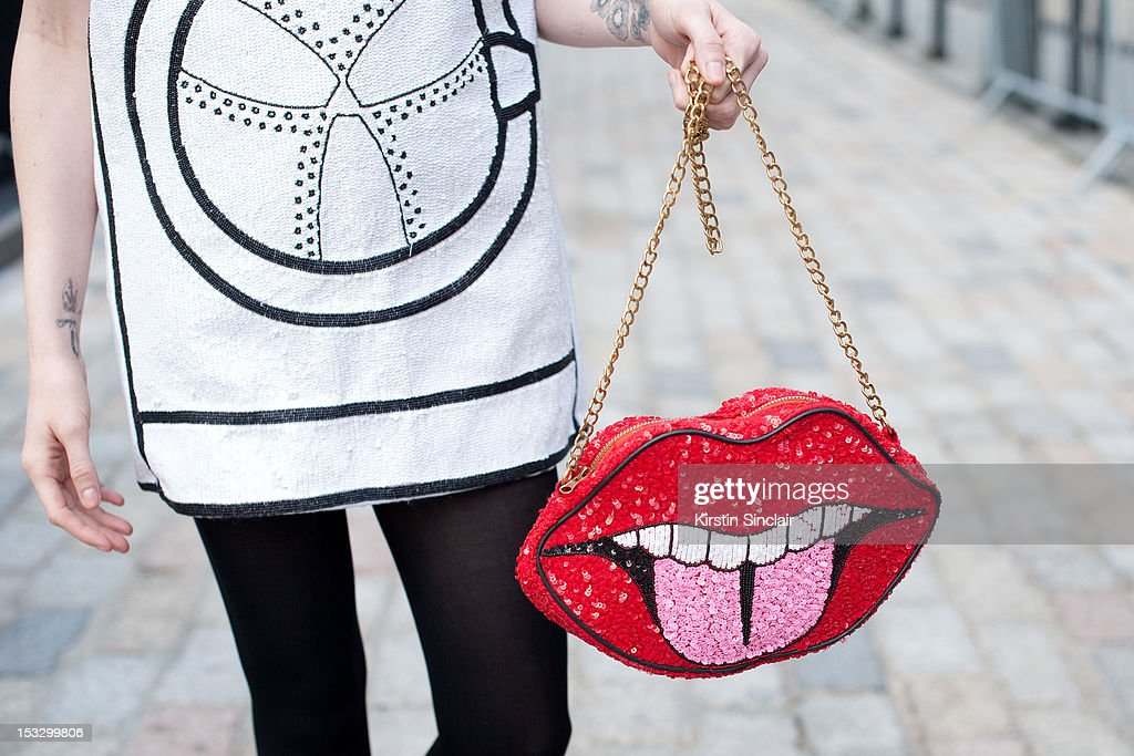 Audrey Napolean LA producer and DJ, wearing a Rodnik dress and bag on day 5 of London Fashion Week Spring/Summer 2013, on September 18, 2012 in London, England.