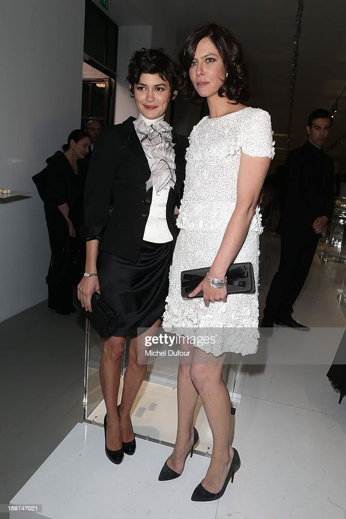 Audrey Tautou and Anna Mouglalis attend the 'No5 Culture Chanel' Exhibition - Photocall at Palais De Tokyo on May 3, 2013 in Paris, France.