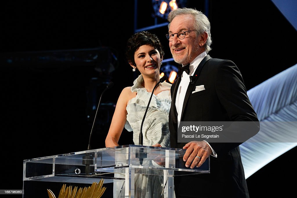 <a gi-track='captionPersonalityLinkClicked' href=/galleries/search?phrase=Audrey+Tautou&family=editorial&specificpeople=212727 ng-click='$event.stopPropagation()'>Audrey Tautou</a> and <a gi-track='captionPersonalityLinkClicked' href=/galleries/search?phrase=Steven+Spielberg&family=editorial&specificpeople=202022 ng-click='$event.stopPropagation()'>Steven Spielberg</a> speak during the Opening Ceremony of the 66th Annual Cannes Film Festival at the Palais des Festivals on May 15, 2013 in Cannes, France.