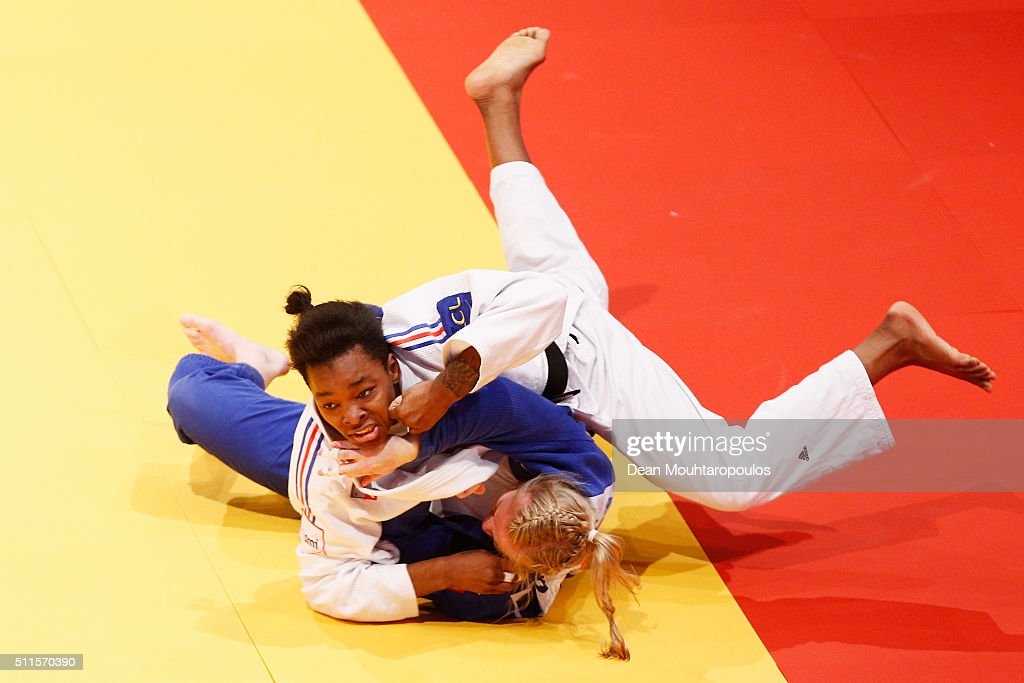 Audrey Tcheumeo (White top) of France and Luise Malzahn of Germany compete during the Dusseldorf Judo Grand Prix in their Womens -78kg Gold medal match held at Mitsubishi Electric Halle on February 21, 2016 in Dusseldorf, Germany.