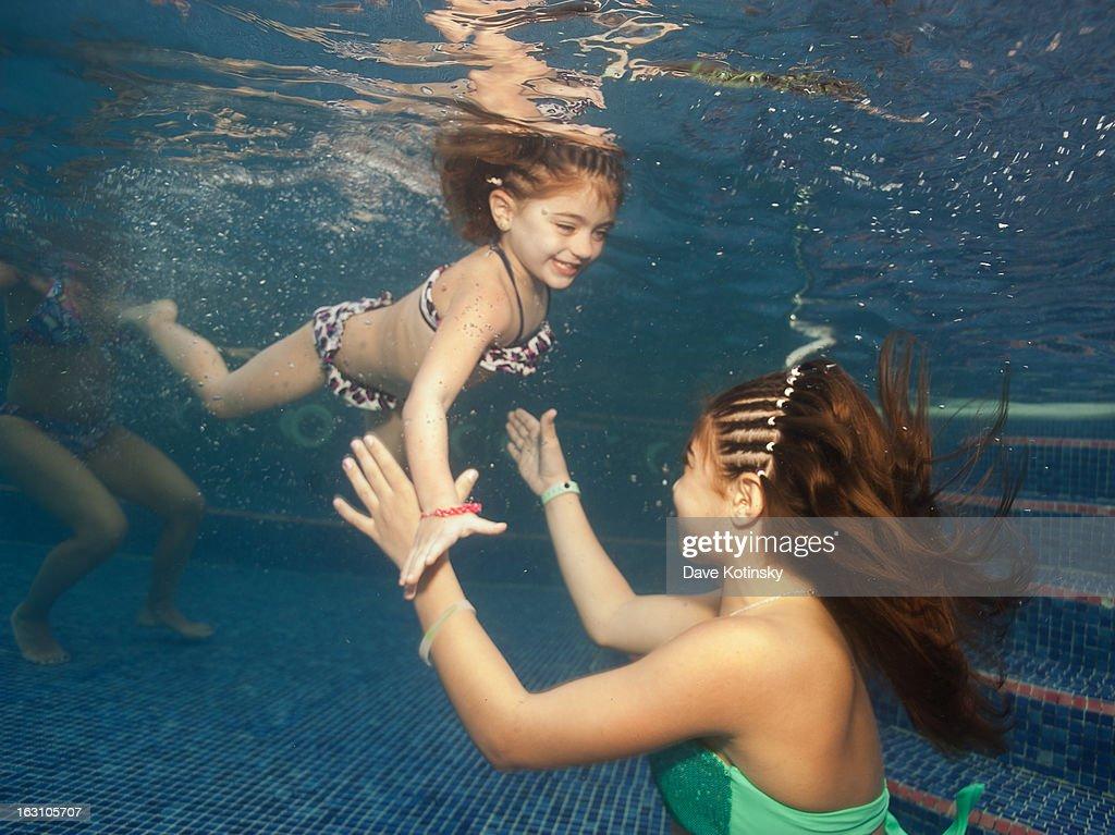Audriana Giudice and Gia Giudice pose underwater at Majestic Resort on March 4, 2013 in Punta Cana, Dominican Republic.