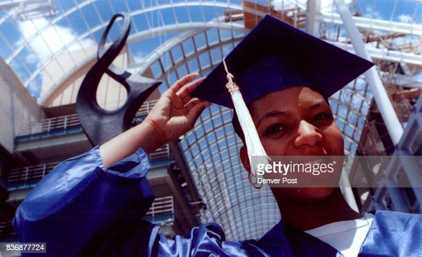 Audrienne Braxton adjusts her Mortarboard a outside Boettcher where she graduated from Emily Griffith opportunity school Credit Denver Post