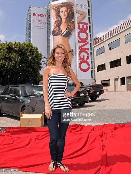 Audrina Patridge unveils her new Bongo swimsuit billboard on Sunset Blvd on April 7 2011 in Los Angeles California