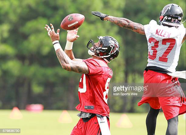 Aug 10 2015 Atlanta Falcons tight end Levine Toilolo grabs a Matt Ryan pass over Atlanta Falcons cornerback Ricardo Allen during training camp at The...