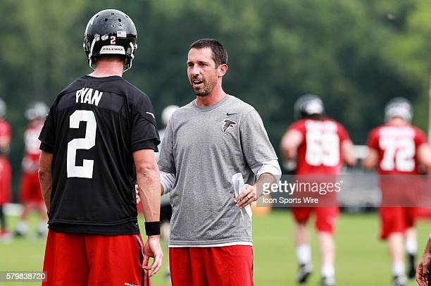 Aug 10 2015 Offensive coordinator Kyle Shanahan talks to Atlanta Falcons quarterback Matt Ryan during training camp at The Falcons Headquarters in...