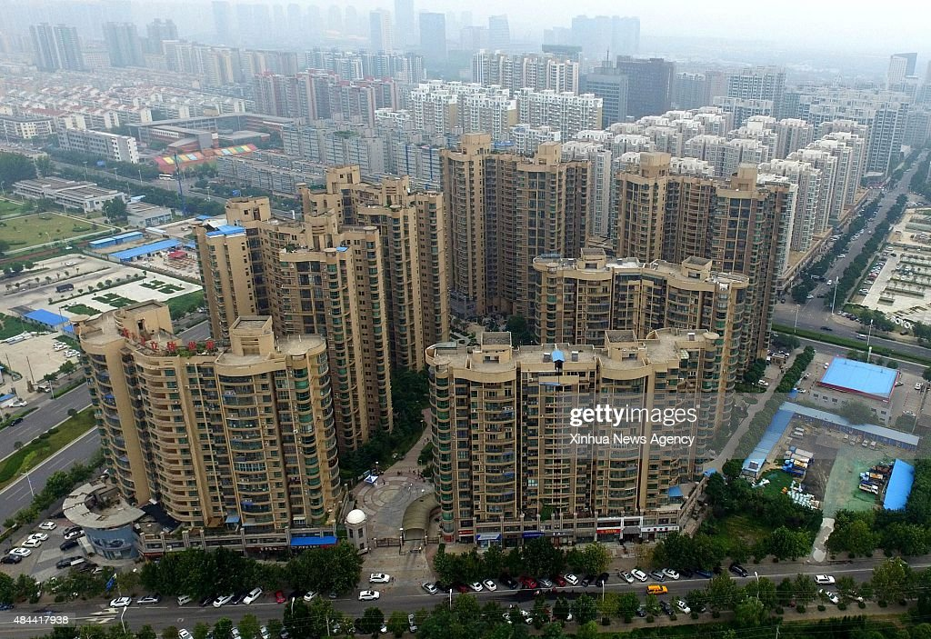 ZHENGZHOU Aug 18 2015 Photo taken on Aug 17 2015 shows residential buildings in Zhengzhou capital of central China's Henan Province China's housing...