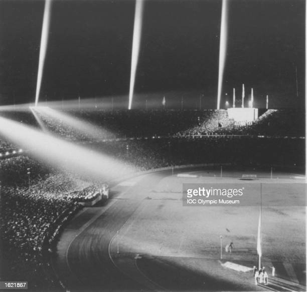 The Olympic flag is lowered in the Olympic Stadium during the Closing Ceremony of the 1936 Olympic Games in Berlin. \ Mandatory Credit: IOC Olympic Museum /Allsport