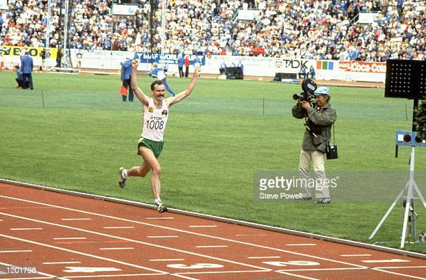 Rob de Castella of Australia celebrates as he crosses the line to win the Marathon event during the World Championships at the Olympic Stadium in...