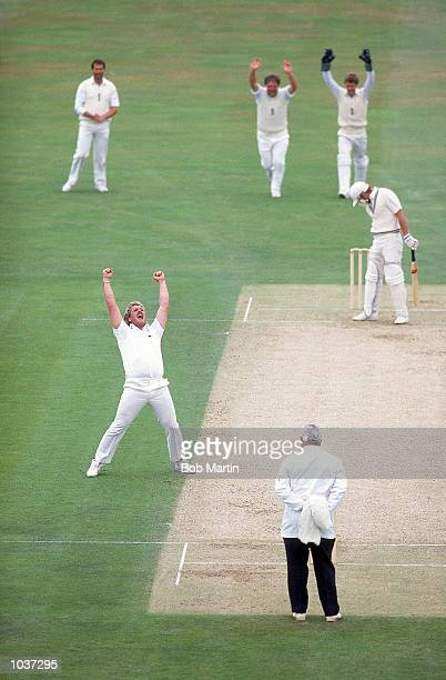 Ian Botham of England equals the World Record for most Test Wickets taken during the Test match against New Zealand at The Oval in London Mandatory...