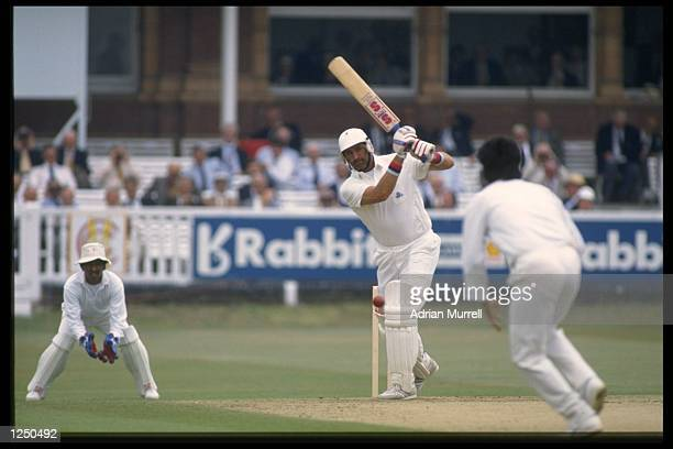 India wicket keeper Kiran More can only watch as Graham Gooch of England cover drives during his mammoth innings of 333 in the Test Match at Lords...
