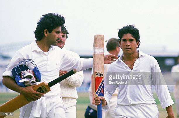 Sachin Tendulkar of India celebrates hitting 119 runs not out during the Second Test match against England played at Old Trafford in Manchester...
