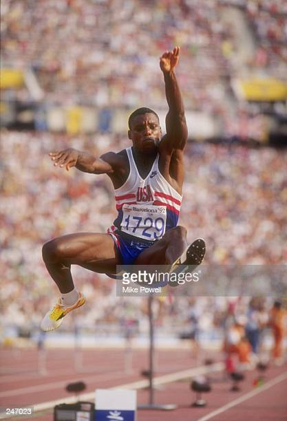 Carl Lewis of the United States stretches for distance in the long jump at the Olympic Games in Barcelona Spain