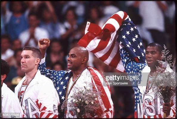 Chris Mullin Charles Barkley and Magic Johnson of Team USA the Dream Team on the victor's podium after winning the gold medal in the men's basketball...