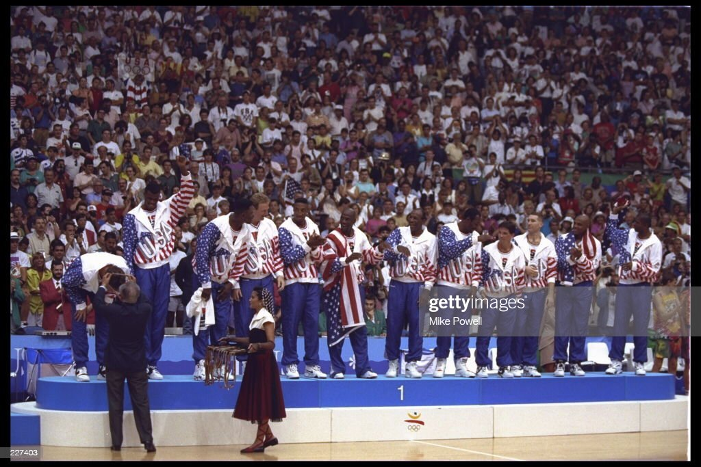 Christian Laettner of the USA Dream Team bends over to receive his gold medal during the medal ceremony following the basketball finals in the 1992 Summer Olympics in Barcelona, Spain. Mandatory Credit: Mike Powell/Allsport