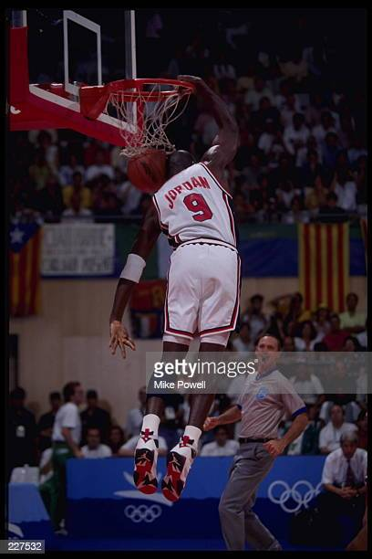 Guard Michael Jordan of the USA Dream Team slam dunks the ball during the USA's game in the basketball finals of the 1992 Summer Olympics in...